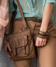 Purse detail with young women.