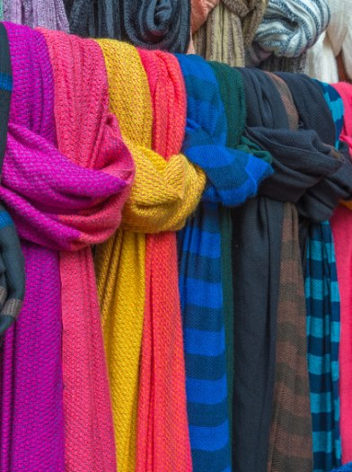 Colorful of scarves in a textiles market.